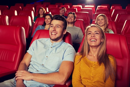 comedy: happy friends watching comedy movie in theater