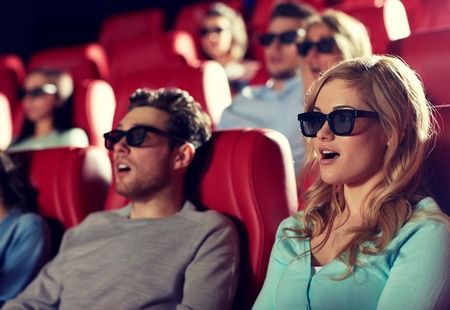 thriller: friends with 3d glasses watching horror or thriller movie in theater Stock Photo