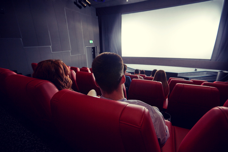 family movies: couple watching movie in theater from back Stock Photo