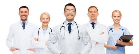 doctors smiling: international group of smiling medics or doctors with clipboard and stethoscopes over blue background