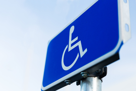 disabled parking sign: traffic laws and highway code concept - close up of road sign for disabled outdoors