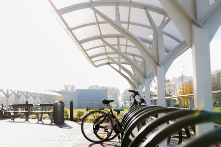 storage: transport, storage and safety concept - close up of bicycle street parking outdoors