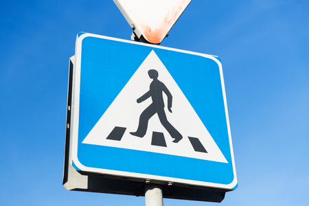 walkway: safety, traffic laws and highway code concept - close up of pedestrian crosswalk road sign Stock Photo