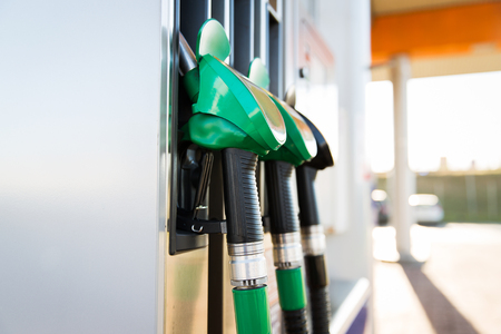 object, fuel, oil, tank and transport concept - close up of gasoline hose at gas station Banque d'images