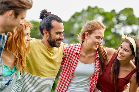 young group: friendship, leisure, summer and people concept - group of smiling friends outdoors Stock Photo