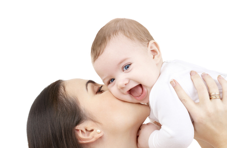 baby blue: family and happy people concept - mother kissing her baby Stock Photo