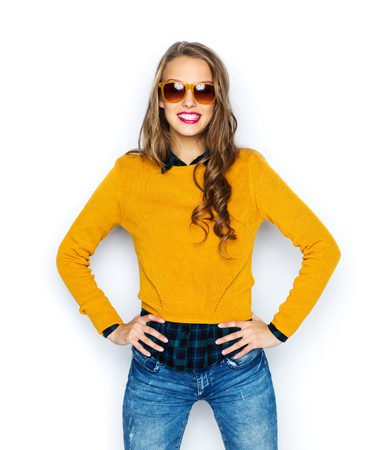 glasses model: people, style and fashion concept - happy young woman or teen girl in casual clothes and sunglasses