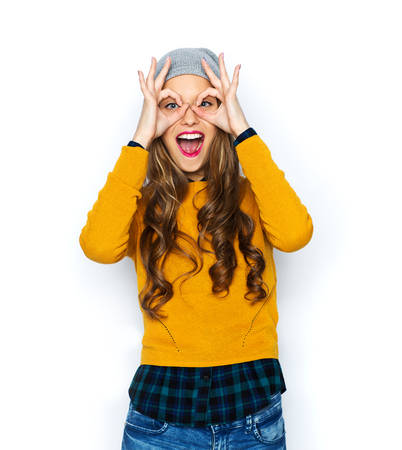 people, style and fashion concept - happy young woman or teen girl in casual clothes and hipster hat having fun Stockfoto
