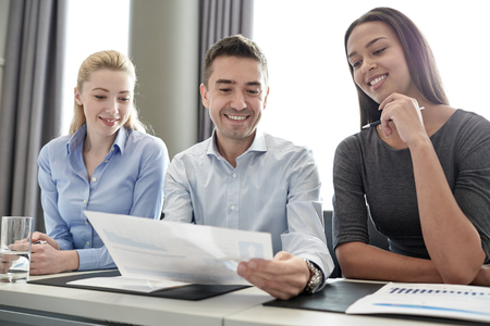 business, people and teamwork concept - group of smiling businesspeople meeting in office Stock Photo