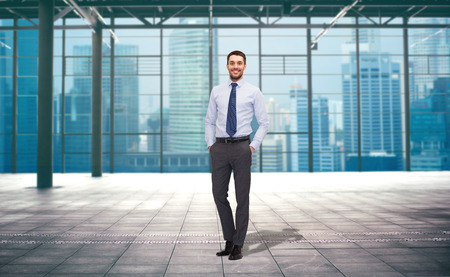 empty of people: business, people and office concept - handsome businessman over empty urban city construction background