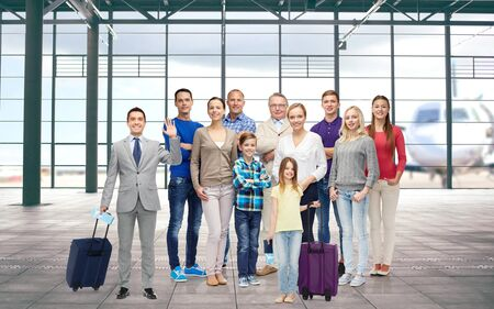latin family: generation, travel, tourism and people concept - group of smiling people with luggage over airport terminal background