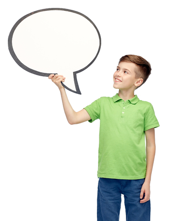 pre adolescent boys: childhood, communication, advertisement and people concept - happy smiling boy in green polo t-shirt holding blank white text bubble banner Stock Photo