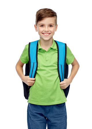 pre adolescent boys: childhood, school, education and people concept - happy smiling student boy with school bag