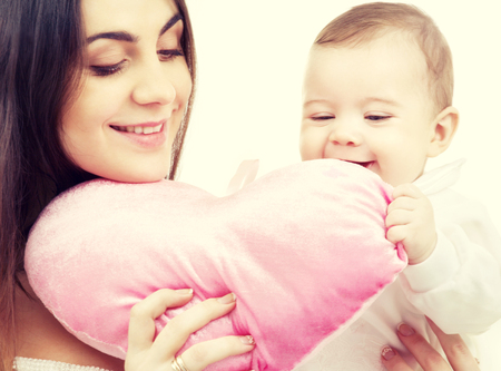 mama: happy baby and mama with heart-shaped pillow