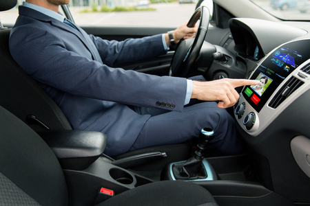 incoming: transport, business trip, technology and people concept - close up of young man in suit driving car and receiving incoming call from woman on board computer screen