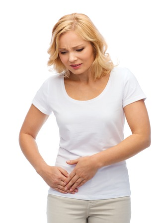 appendicitis: people, healthcare and problem concept - unhappy woman suffering from stomach ache Stock Photo