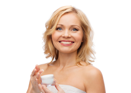 hand care: beauty, people, skincare and cosmetics concept - happy woman with cream jar