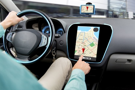 transport, road trip, car driving, technology and people concept - close up of male hand adjusting gps navigator while driving car