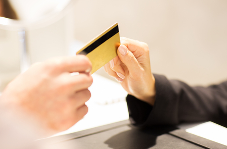 bank manager: business, sale, payment and people concept - close up of customer hand giving credit card to seller or bank manager