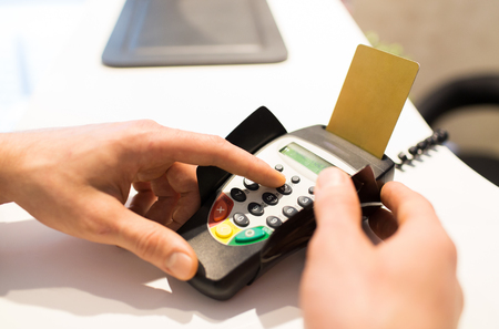 pin code: finance, technology, payment , money and people concept - close up of hand entering pin code to bank terminal with credit car