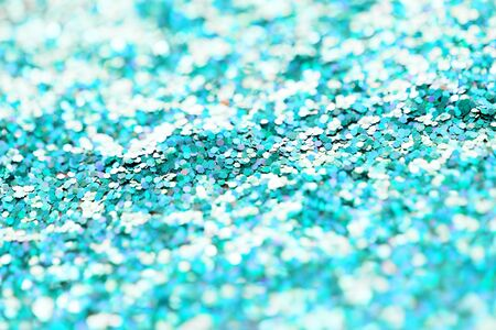 aquamarine: holidays, decoration and texture concept - blue glitter or sequins background