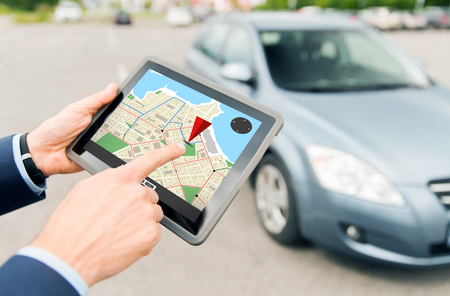 gps: transport, business trip, navigation, technology and people concept - close up of male hands with gps navigator on tablet pc computer and car outdoors