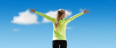 rear: fitness, sport, achievement, people and emotions concept - happy sporty woman enjoying sun and freedom over blue sky and clouds background from back Stock Photo