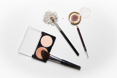 up view: cosmetics, makeup and beauty concept - close up of makeup stuff