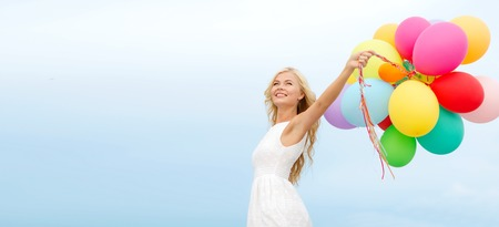 summer holidays: summer holidays, celebration and lifestyle concept - beautiful woman with colorful balloons outside