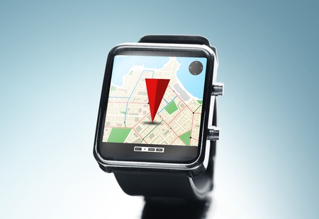 modern technology, object, application and navigation concept - close up of black smart watch with gps and road map on screen over blue background Фото со стока