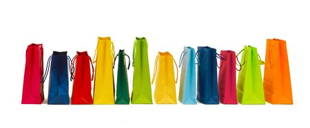 consumerism: sale, consumerism, advertisement and retail concept - many colorful shopping bags