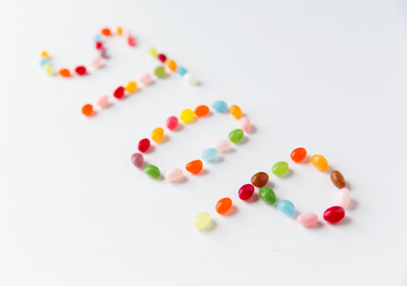 hard stuff: food, sweets, confectionery and unhealthy eating concept - close up of colorful jelly beans candies on table
