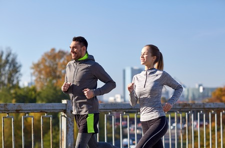 health and fitness: fitness, sport, people and lifestyle concept - happy couple running outdoors