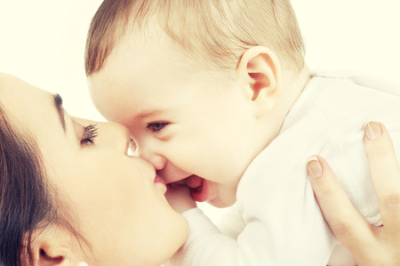 mom son: picture of happy mother with baby over white Stock Photo