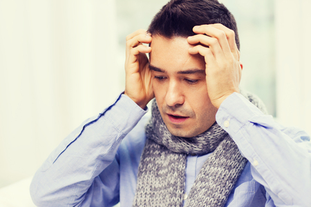 male headache: healthcare, flu, people and medicine concept - close up of ill man with flu suffering from headache at home Stock Photo