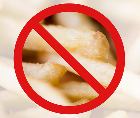 unhealthy diet: fast food, low carb diet, fattening and unhealthy eating concept - close up of french fries behind no symbol or circle-backslash prohibition sign