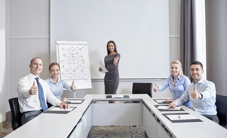 black businessman: business, people and teamwork concept - group of smiling businesspeople meeting and showing thumbs up in office