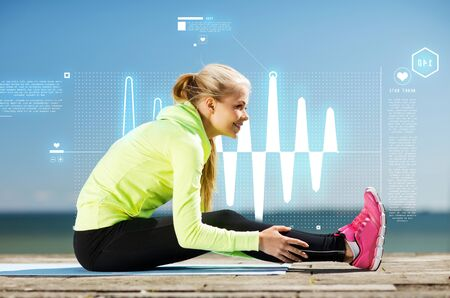 resting heart rate: fitness and lifestyle concept - woman doing sports outdoors