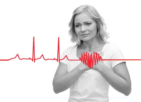 people, healthcare, heart disease and problem concept - unhappy woman suffering from heartache