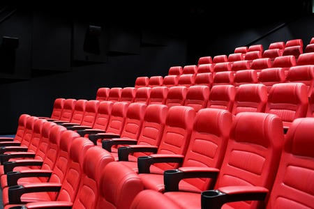 entertainment concept: entertainment and leisure concept - movie theater or cinema empty auditorium with red seats Stock Photo