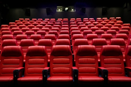 entertainment and leisure concept - movie theater or cinema empty auditorium with red seats Banco de Imagens