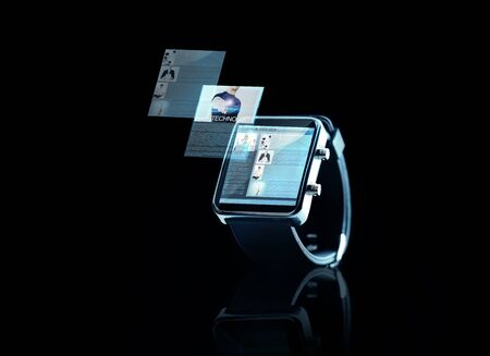 watch over: business, modern technology, object, internet and media concept - close up of black smart watch with web page on screen over black background