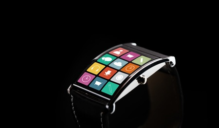 application icons: modern technology, object and media concept - close up of black smart watch with application icons on screen