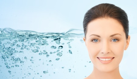 health beauty: beauty, people, moisturizing, body care and health concept - smiling young woman face over water splash background
