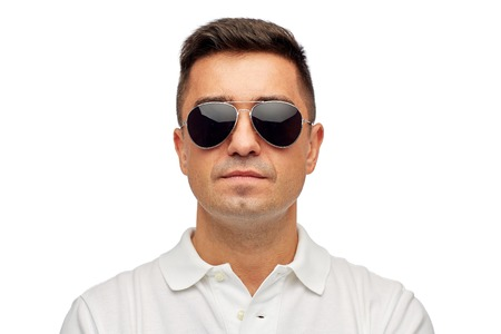 sun glasses: summer, accessories, style and people concept - face of middle aged latin man in white polo t-shirt and sunglasses