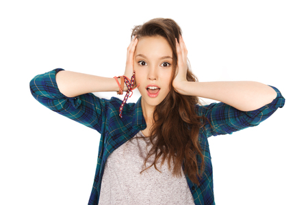 people, hair care, style and teens concept - happy pretty teenage girl holding to head