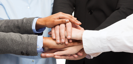 group of hands: business, succcess and winning concept - group of businesspeople celebrating victory