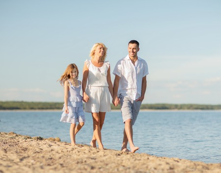 mum and daughter: summer holidays, children and people concept - happy family at the seaside Stock Photo