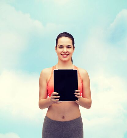 blank tablet: sport, exercise, technology, internet and healthcare - sporty woman with tablet pc blank screen