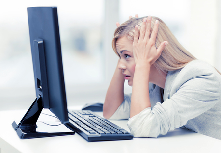 learning computer: picture of stressed businesswoman with computer at work